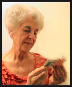 Picture of older lady reading prescription label