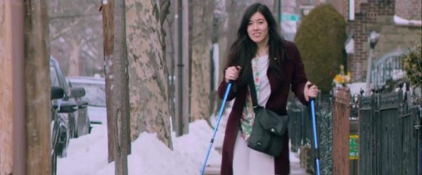 Woman walking using mobility aids